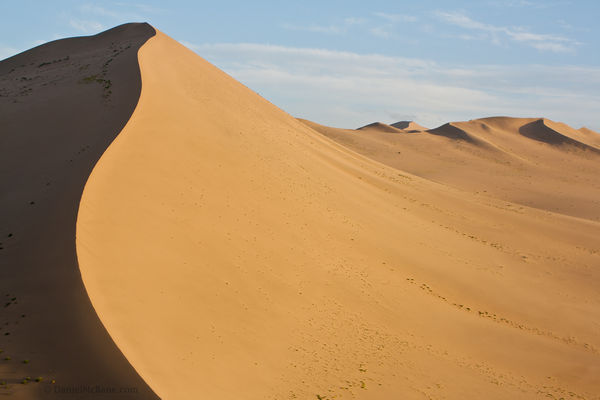 Mingsha sand dune in Dunhuang China at sunset