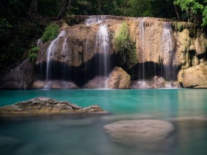 Second tier swimming pool at Erawan Falls in Kanchanaburi Thailand