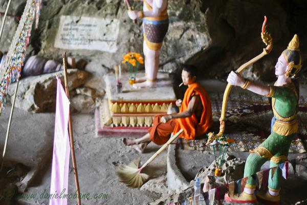Monk Smoking in Laos Cave