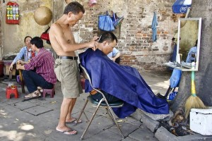 Sidewalk Barber in Asia