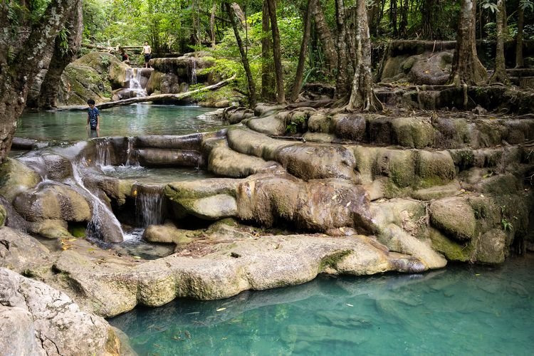 turquoise swimming pools at Erawan Falls in Kanchanaburi Thailand