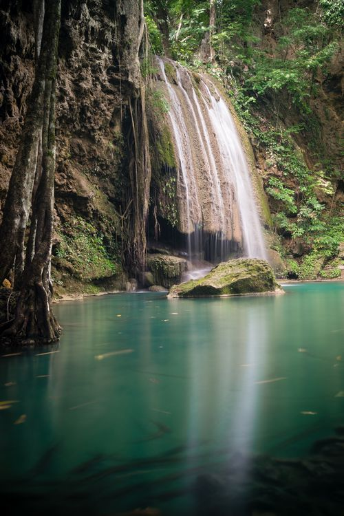 Large waterfall at third tier of Erawan Falls in Kanchanaburi Thailand