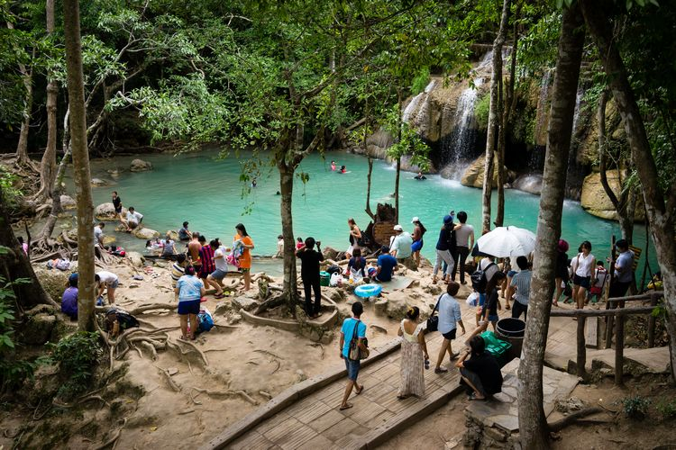 crowds at erawan falls in kanchanaburi thailand