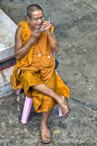 Buddhist Monk in Vientiane Doing Some Grooming