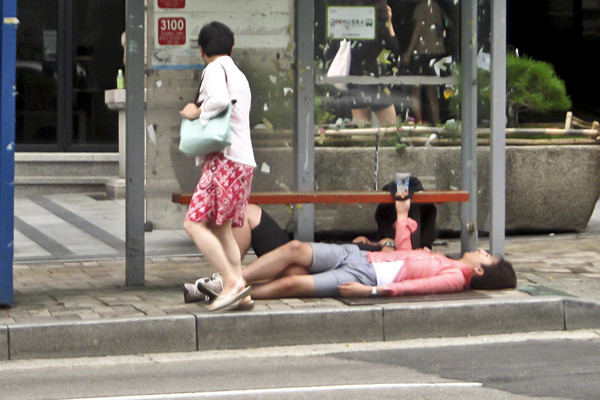 Passed Out Korean at Bus Stop