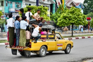 Hanging off the Side of Mandalay's Crowded Public Transport