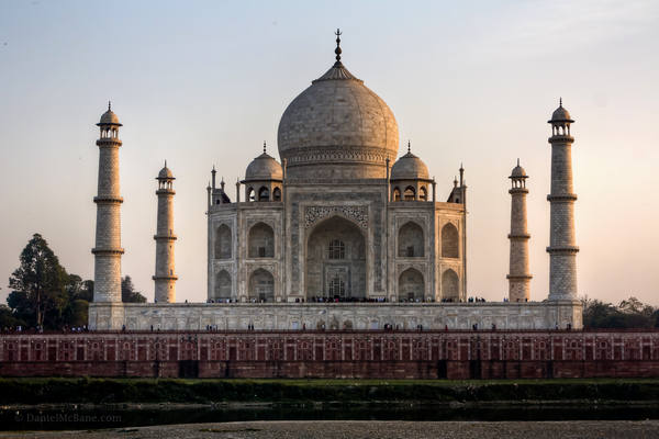 Taj Mahal at dusk across Yamuna River