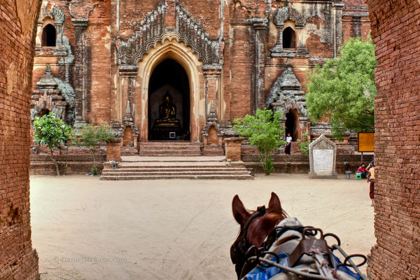 Horse cart approaching temple in Bagan