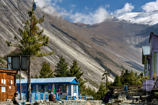 Sheer rock face surrounds town on Annapurna Circuit