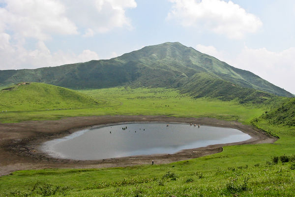 Peak behind meadow on Mount Aso in Kyushu