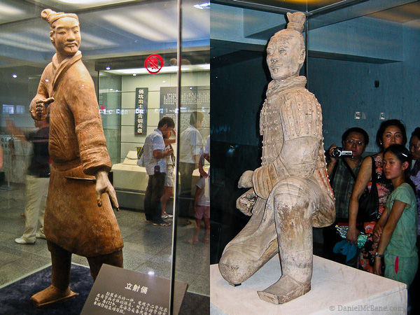 Terracotta warrior statues in a glass case