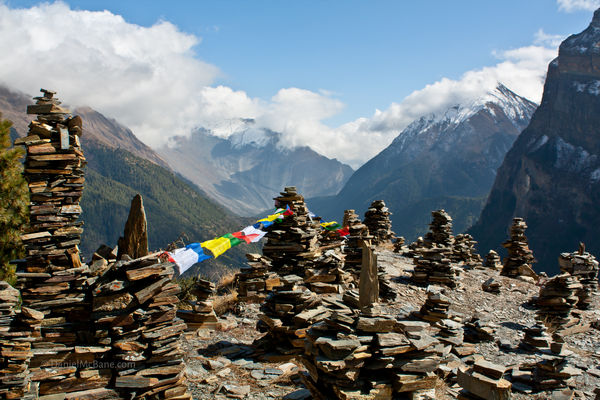 Buddhist stone piles and prayer flags, Annapurna, Nepal