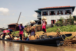 Inle Lake locals loading a boat in Myanmar