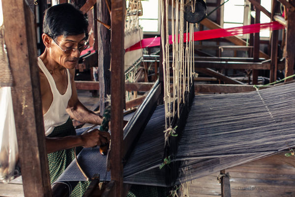 local weaving silk on Inle Lake in Myanmar