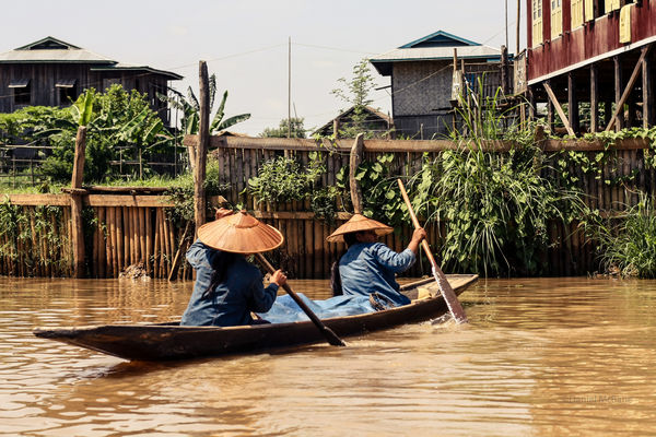 women rowing in a cana on Inle Lake in Myanmar