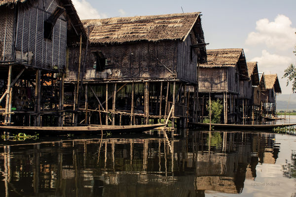 stilt houses floating on Inle Lake in Myanmar