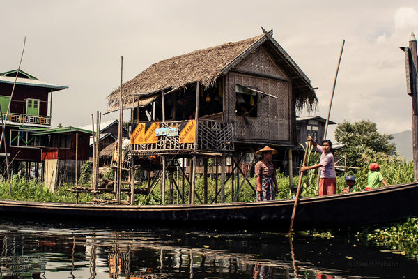 A large family boat on Inle Lake in Myanmar