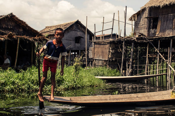 A leg-rowing boy on Inle Lake in Myanmar