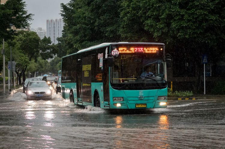 Shenzhen bus on a flooded road during monsoon season
