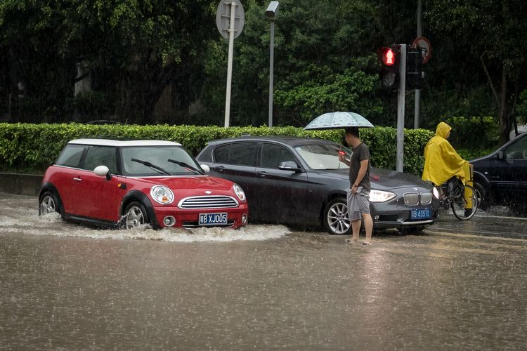 Tiny car on a flooded Shenzhen street