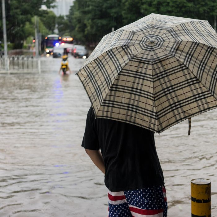 American flag shorts on Chinese man in a flood