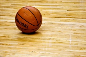 A basketball on a wooden court